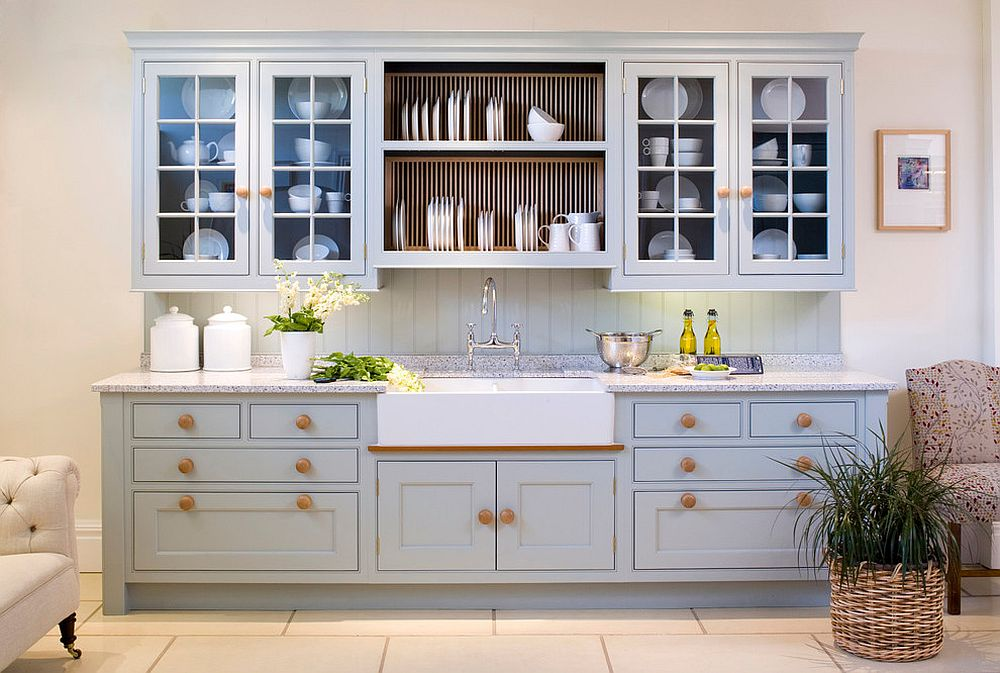 French farmhouse kitchen with a gorgeous plate rack at the heart of its shelving