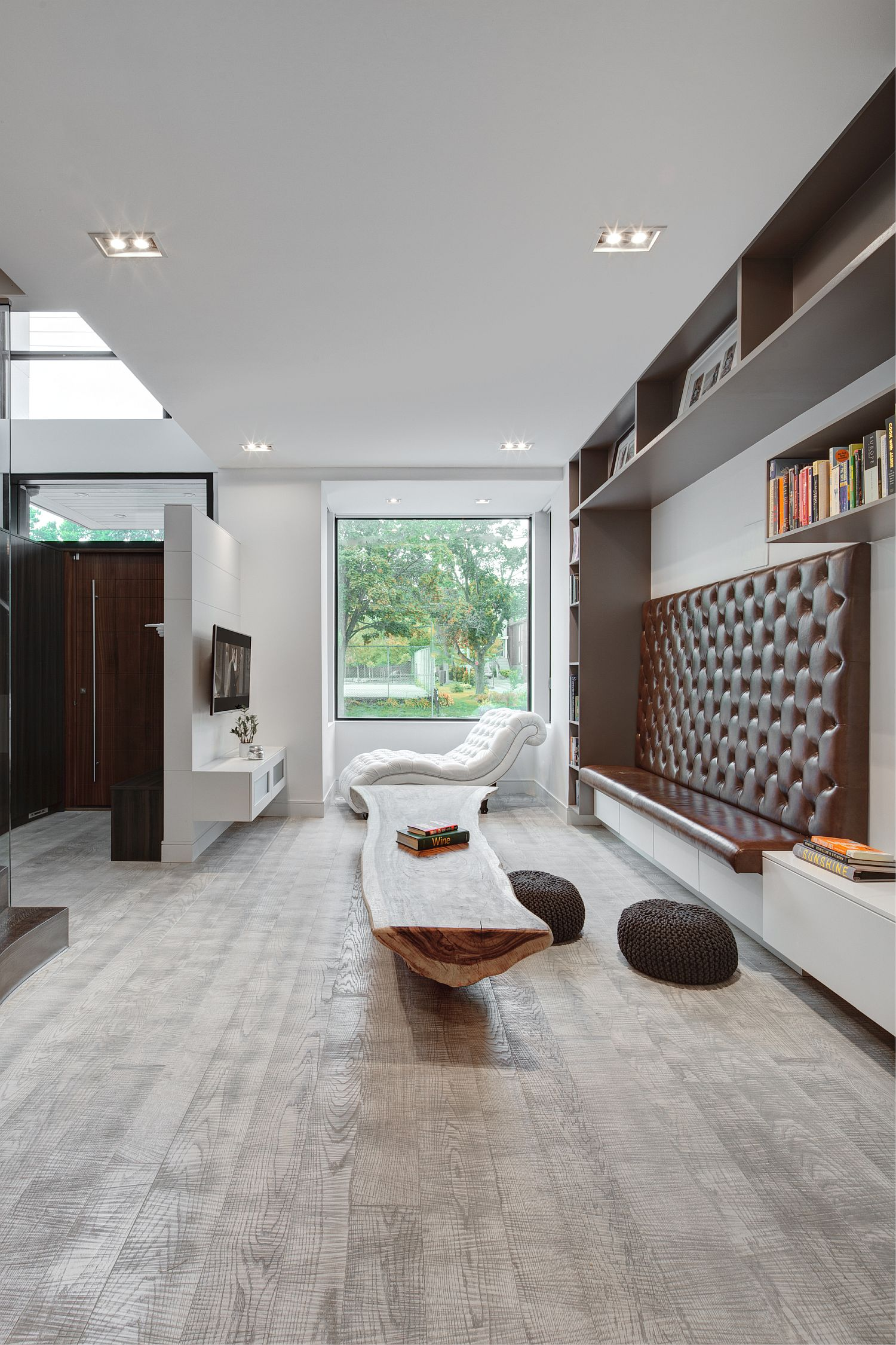 Hardwood-floors-and-smart-lighting-unify-different-rooms-of-the-house