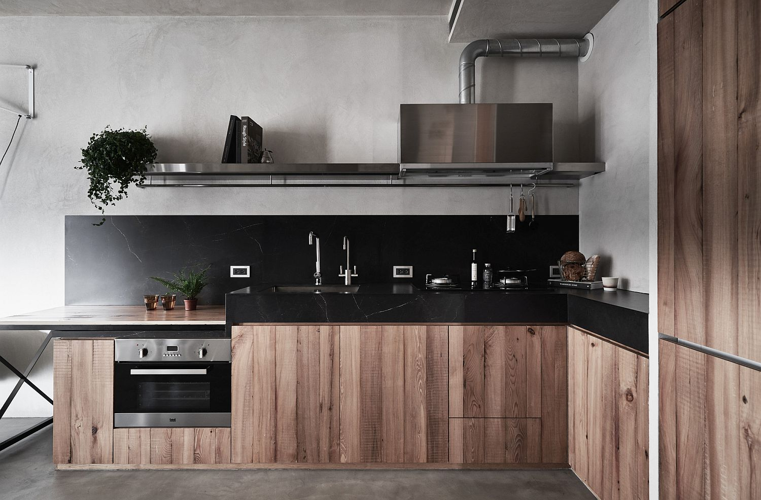 L-shaped kitchen in the corner with dark countertops and wooden cabinets