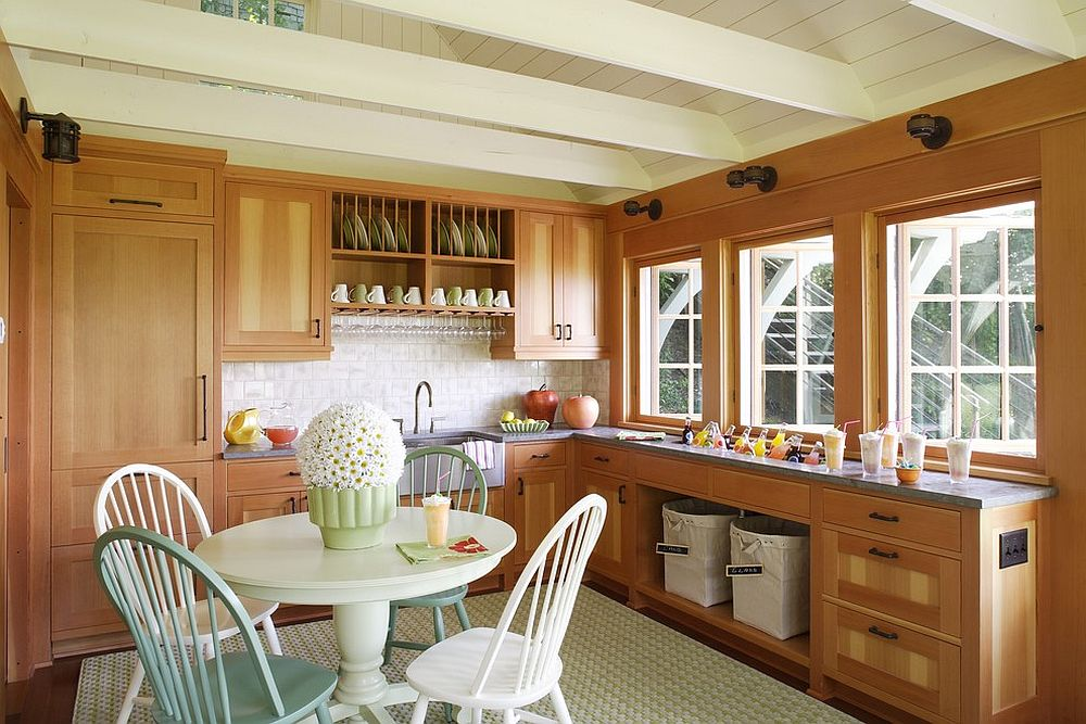 Light filled transitional kitchen with low ceiling and wooden cabinets