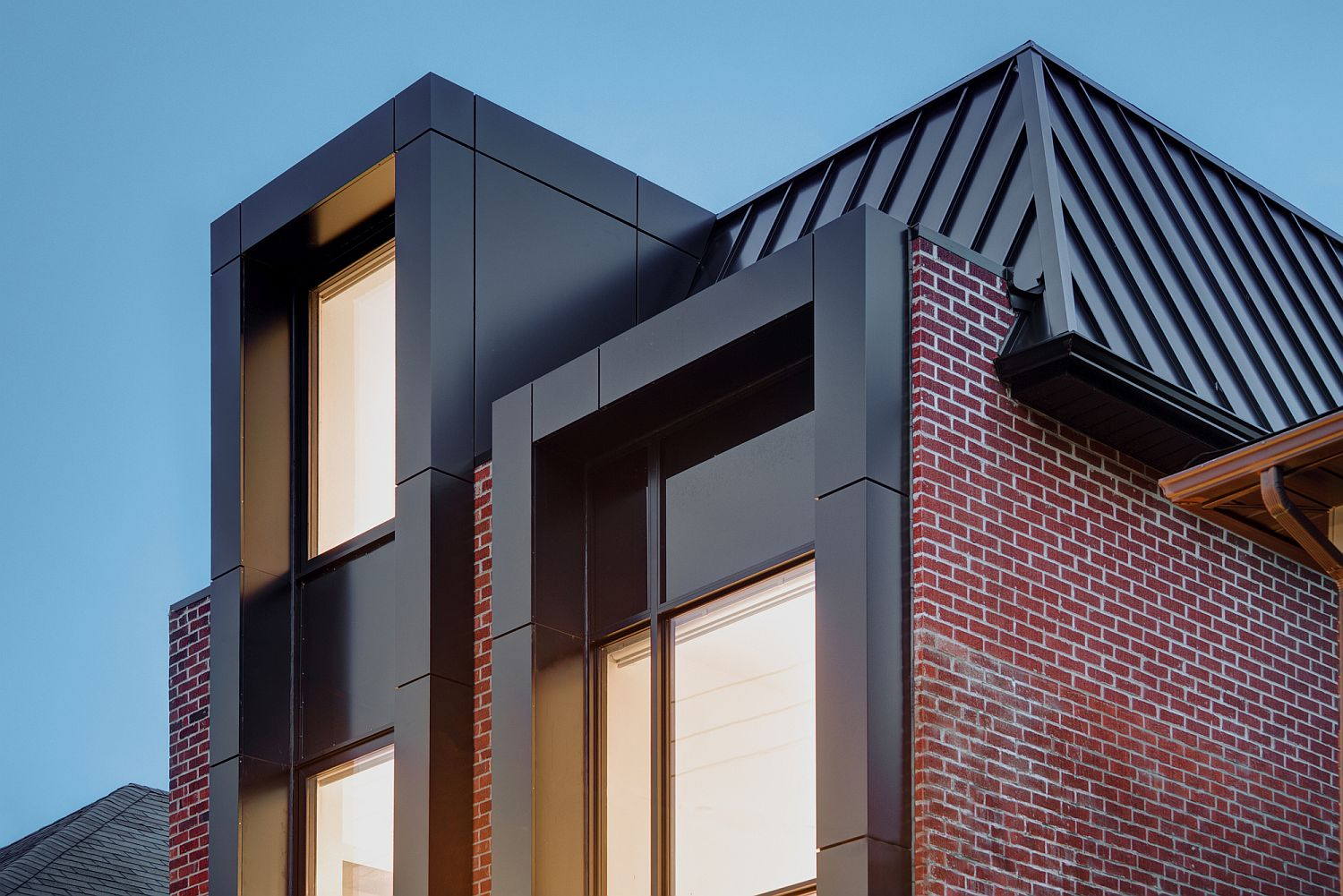 Metal-glass-and-brick-shape-the-exterior-of-this-Toronto-home