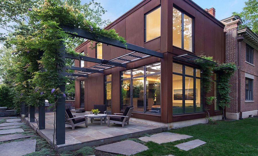 Modern-extension-of-Georgian-home-clad-in-cor-ten-steel