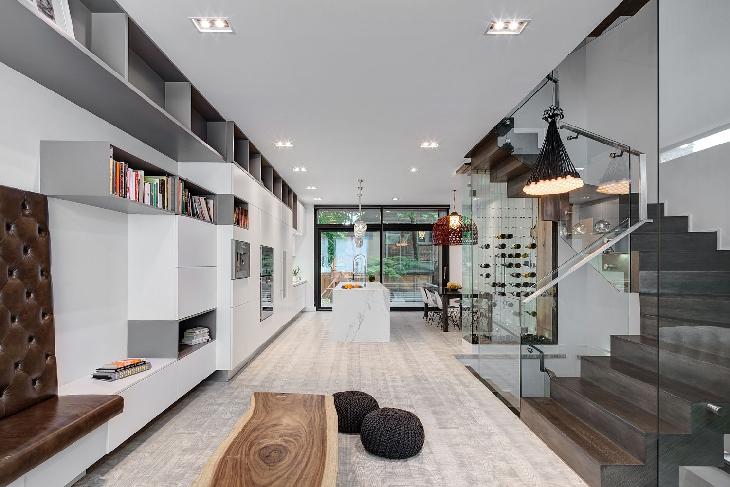 Open-plan-living-area-of-the-modern-Toronto-home-in-white