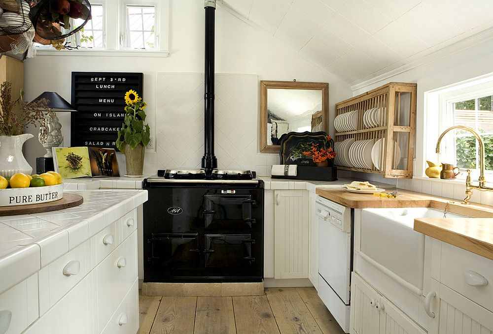 Scandinavian style kitchen in black and white with a plate rack in the corner