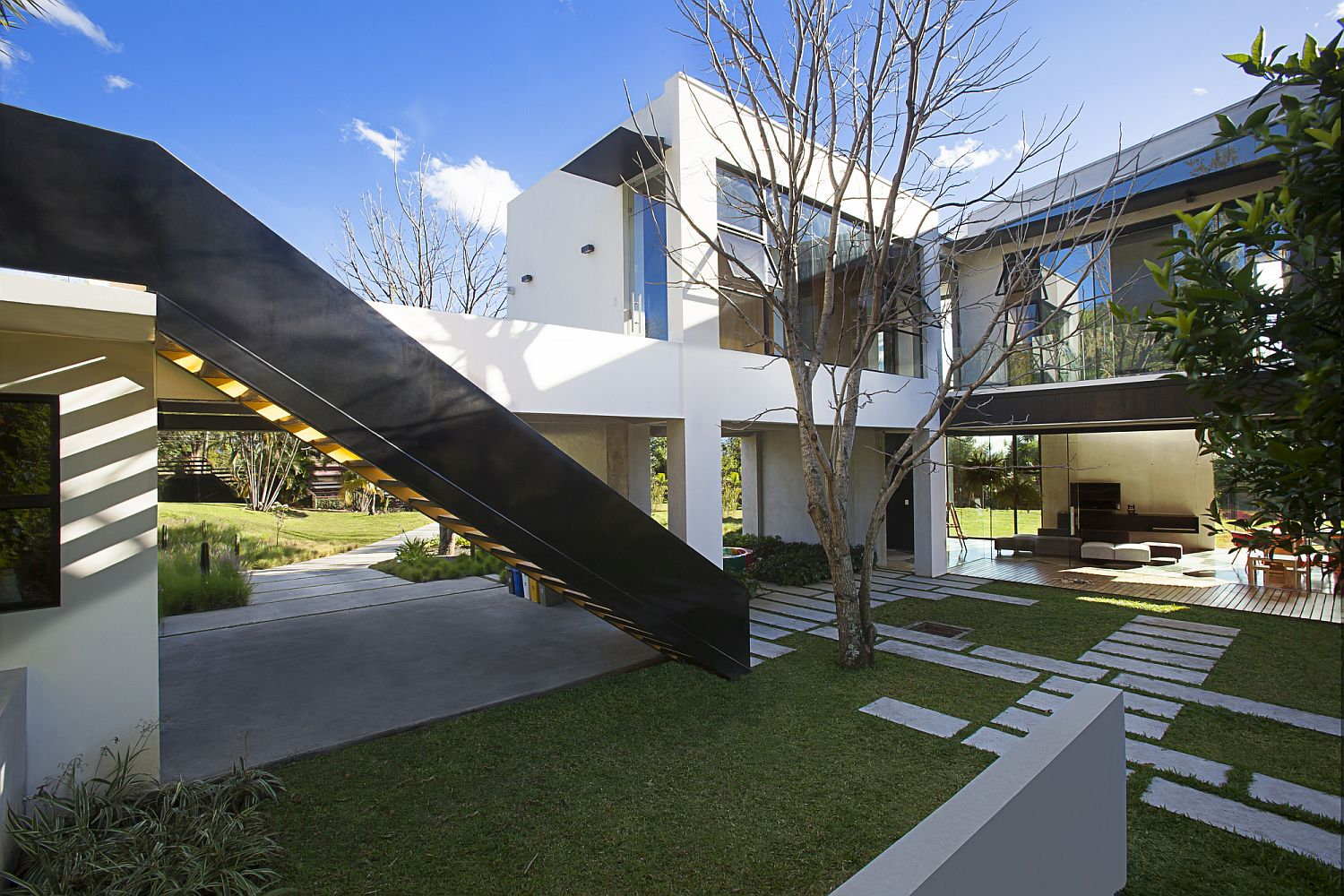 Series of courtyards, gardens and walkways around the modern home