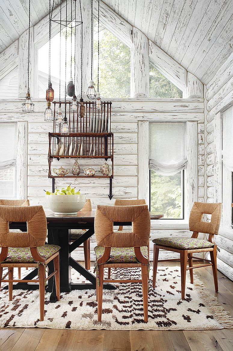 Spacious, double height dining room with rustic style and a plate rack