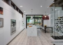 Spacious-kitchen-and-dining-area-in-white-with-wine-storage-217x155