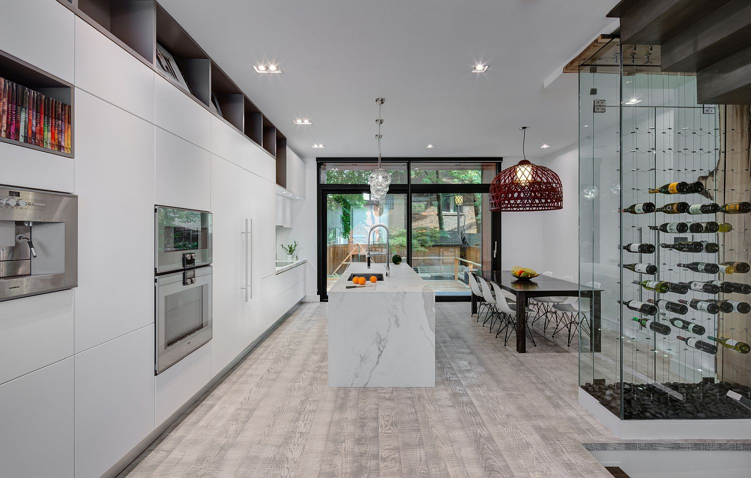 Spacious-kitchen-and-dining-area-in-white-with-wine-storage