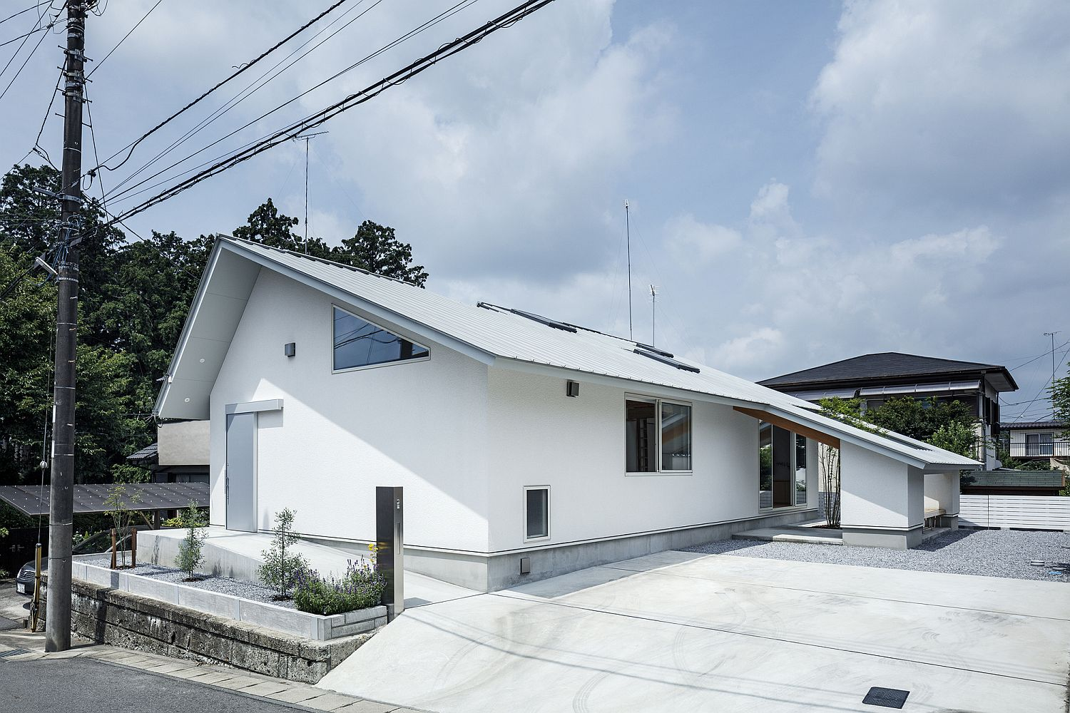 House D: Japanese Home with an Eccentric Gabled Roof and Unique Floor Plan