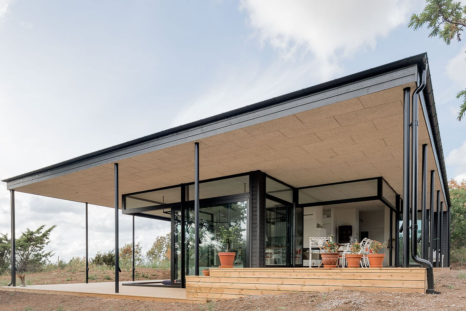 Structure of the roof provides protection from the elements as the homeowners enjoy the outdoors