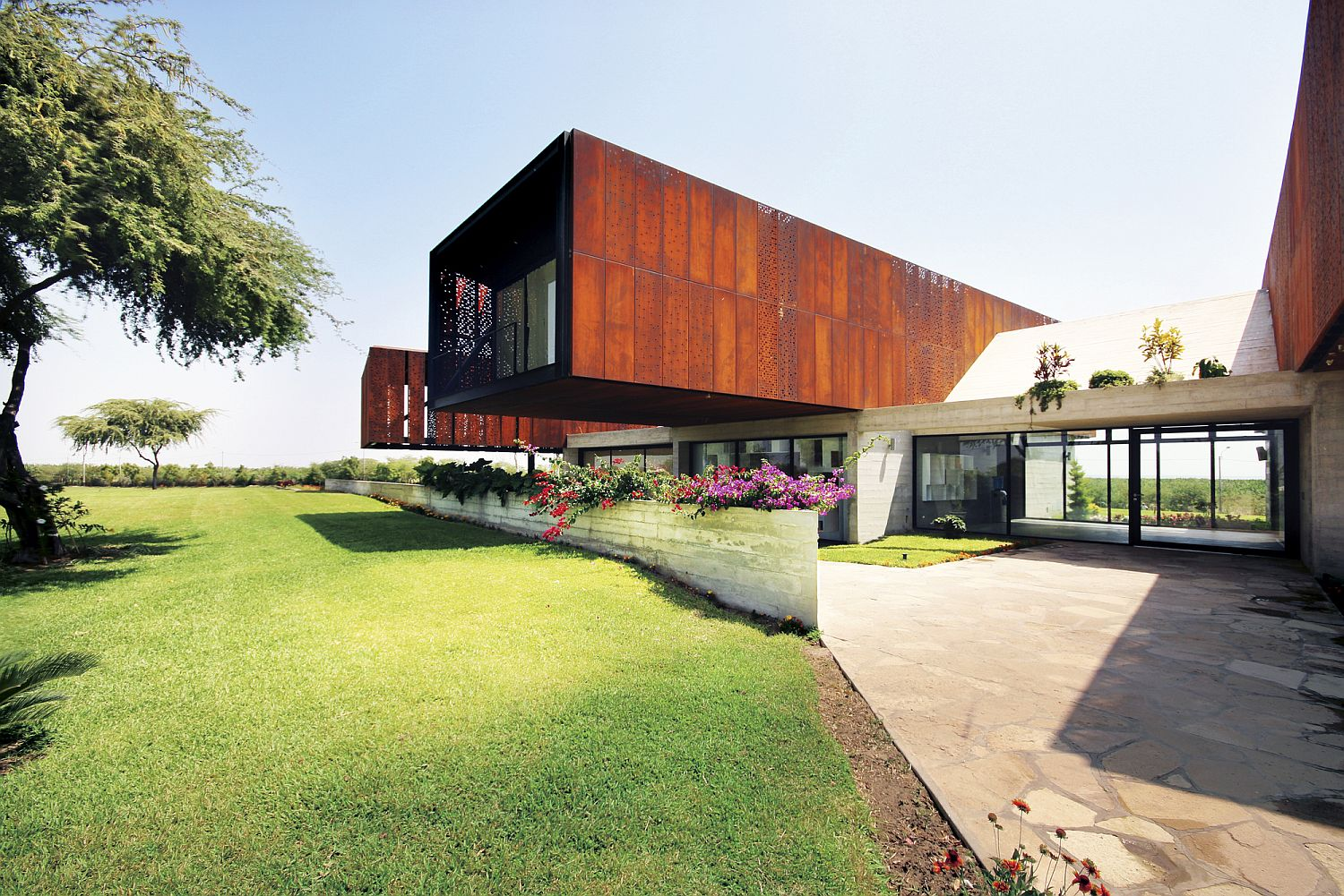 Stunning cantilevered corten clad upper level of the home in Peru