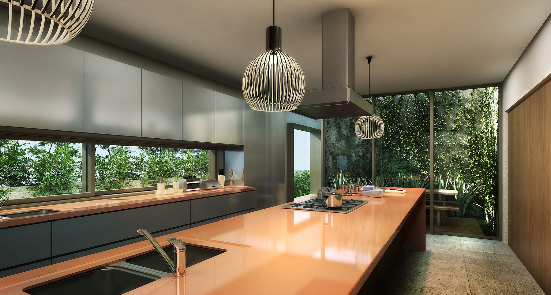Stunning contemporary kitchen inside the house with a view of the terrace and garden