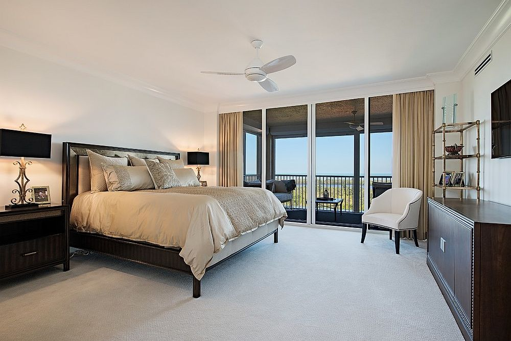 Transitional bedroom with bedding and drapes in beige