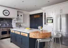 White-and-navy-blue-handpainted-kitchen-is-both-smart-and-classic-217x155
