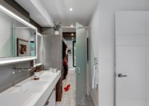 White-modern-bathroom-with-polished-stone-surfaces-217x155