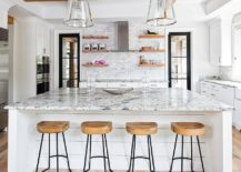 Wooden-beams-add-visual-and-textural-beauty-to-the-modern-rustic-kitchen-in-white-217x155