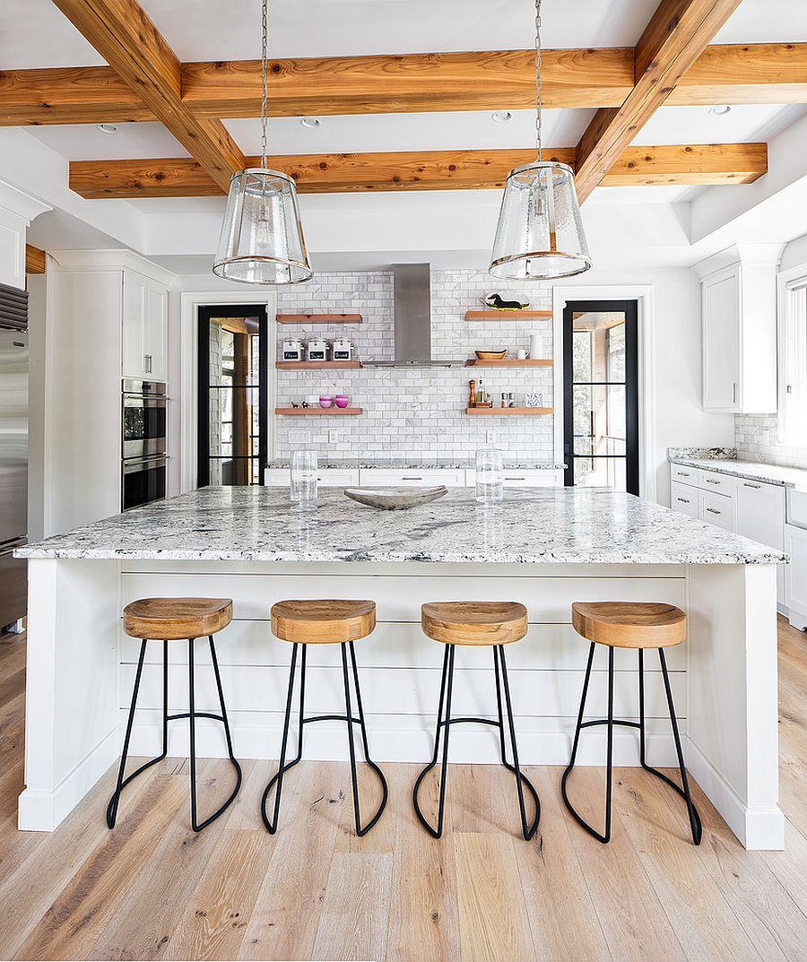 Wooden beams add visual and textural beauty to the modern rustic kitchen in white