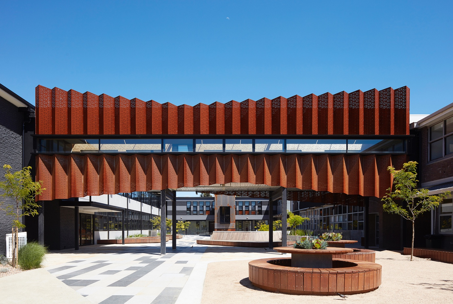 Zig-zag-corten-panels-for-the-exterior-of-Flyover-Gallery-at-Caroline-Chisholm-College