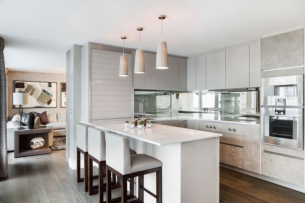 A-mirrored-backsplash-for-the-contemporary-kitchen-in-white