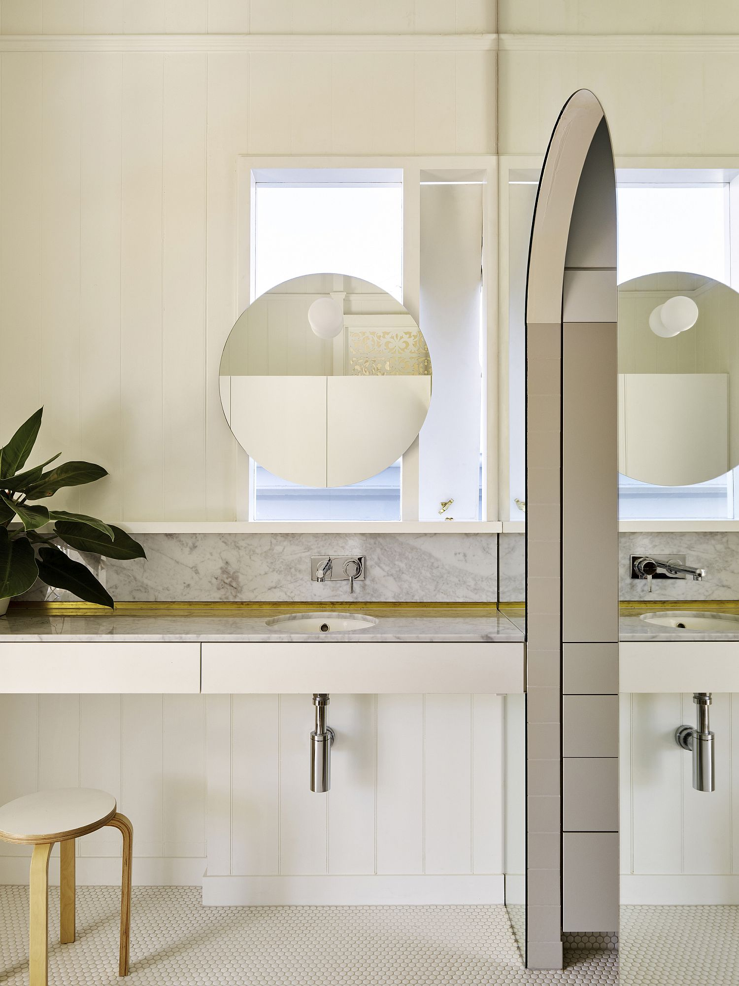 A touch of gold brightens the bathroom in white and wood
