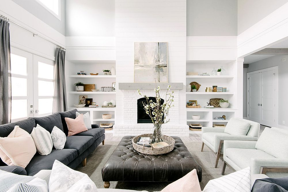 All-white living room with shelves that blend into the backdrop