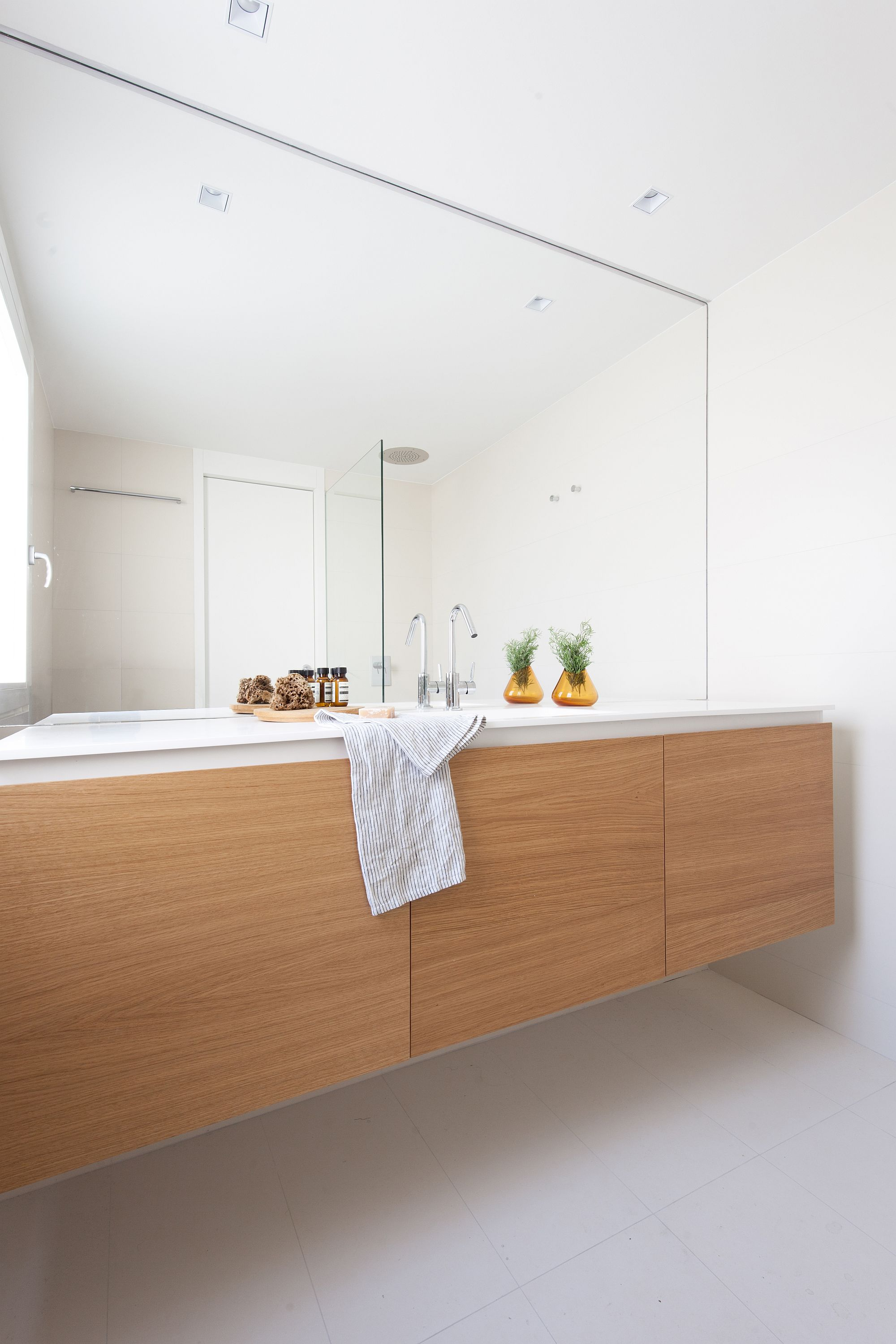 Bathroom in white with floating wooden vanity