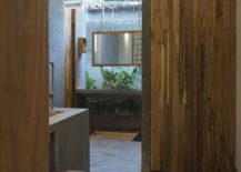 Bathroom-in-wood-and-concrete-inside-the-Hill-Lodge-217x155