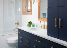 Beautiful-Navy-blue-vanity-and-cabinets-with-brass-handles-for-the-bathroom-217x155