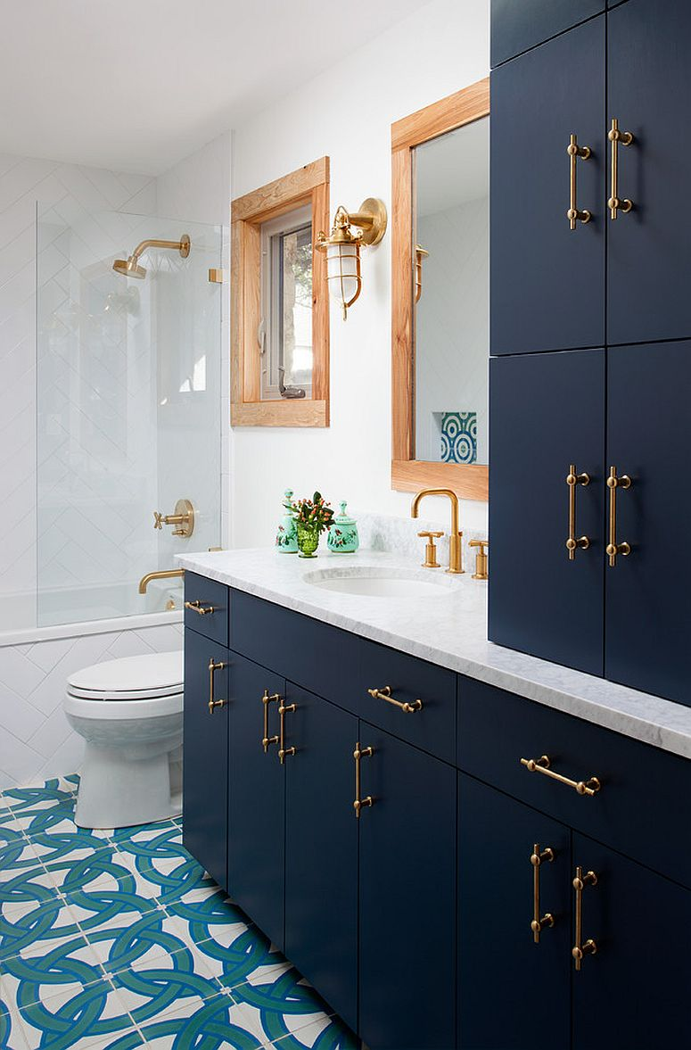 Beautiful-Navy-blue-vanity-and-cabinets-with-brass-handles-for-the-bathroom