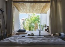 Bedroom-of-the-Hill-Lodge-flows-into-the-deck-and-pool-area-outside-217x155