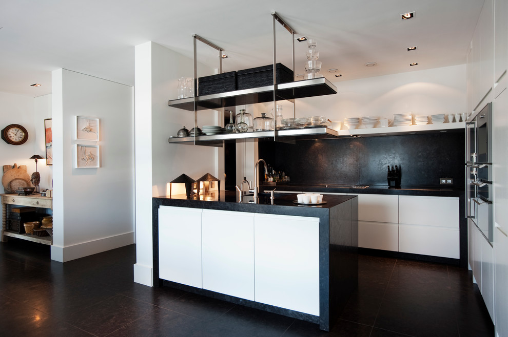 Black-backsplash-can-anchor-the-kitchen-in-white-beautifully