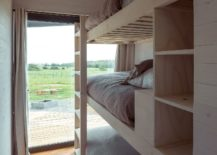 Bunk-beds-of-the-kids-bedroom-with-a-view-of-the-distant-ocean-217x155