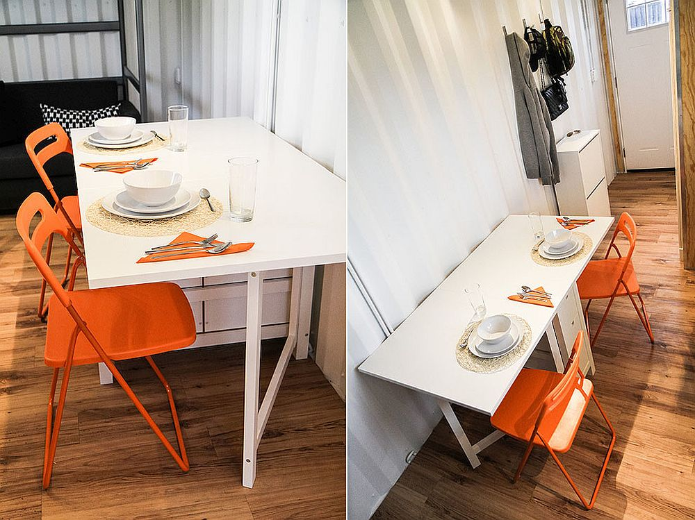 Chairs bring bright orange to the small dining space for two