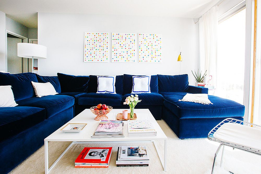 Chic living room in white with bright navy blue sectional