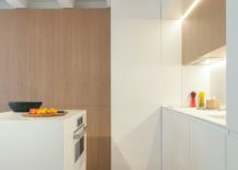 Cleverly-hidden-shelves-cabinets-and-folding-furniture-pieces-transform-this-Barcelona-apartment-217x155