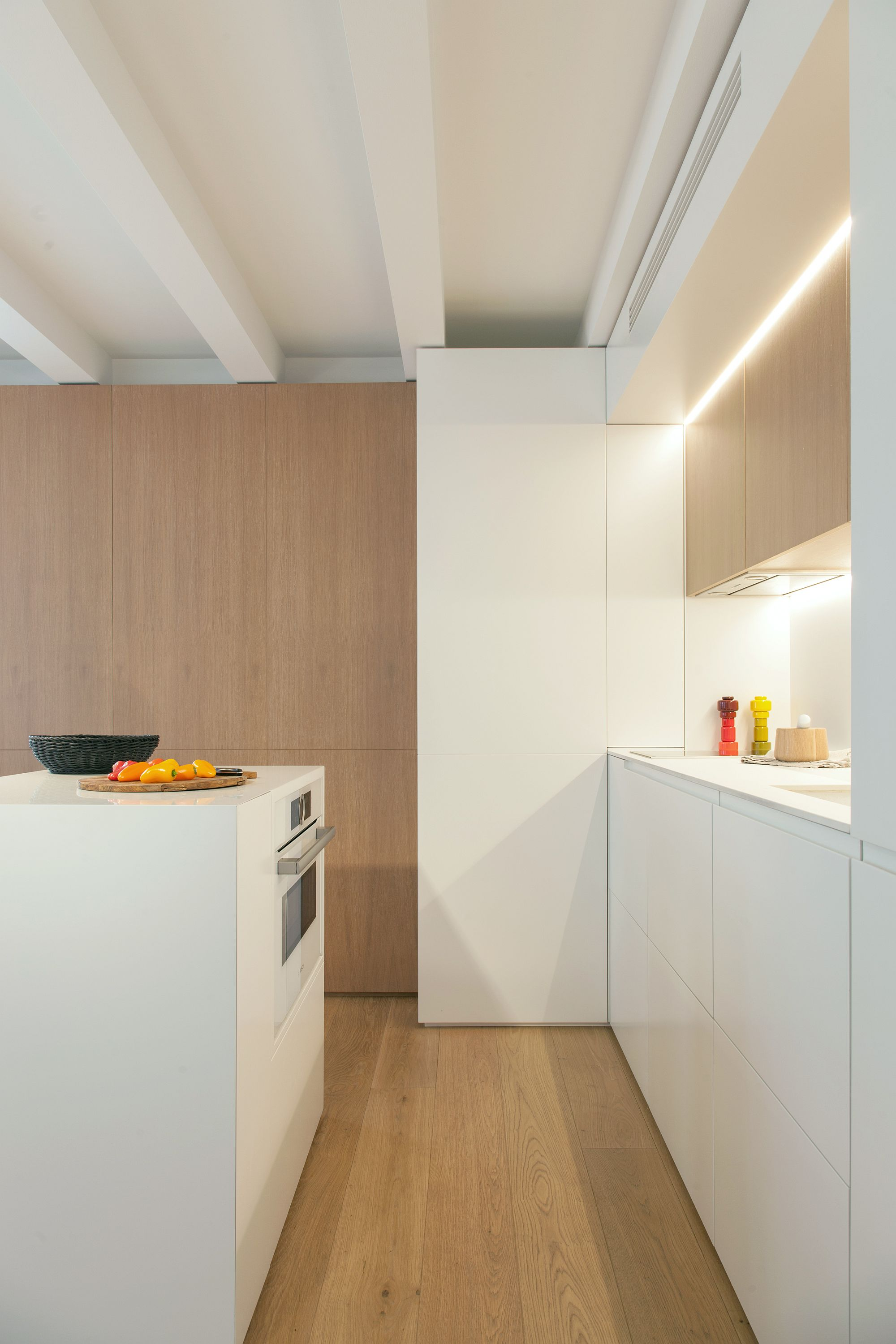 Cleverly hidden shelves, cabinets and folding furniture pieces transform this Barcelona apartment