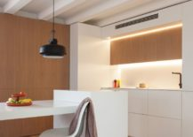 Concealed-wooden-beams-LED-lighting-and-white-modern-finishes-present-a-picture-of-refinement-217x155