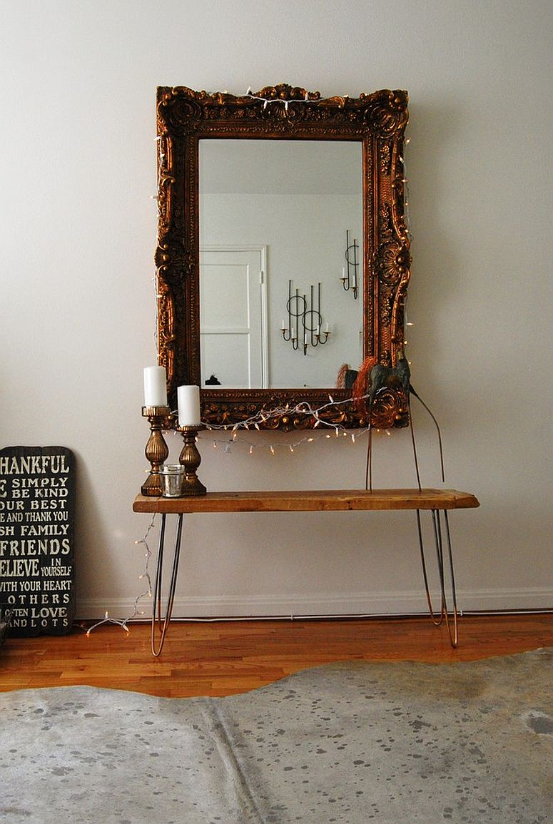 Creating a lovely focal point in the eclectic bedroom with mirror and string lights
