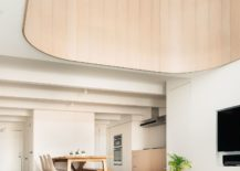 Curved-wooden-element-lends-softness-to-the-minimal-modern-interior-217x155
