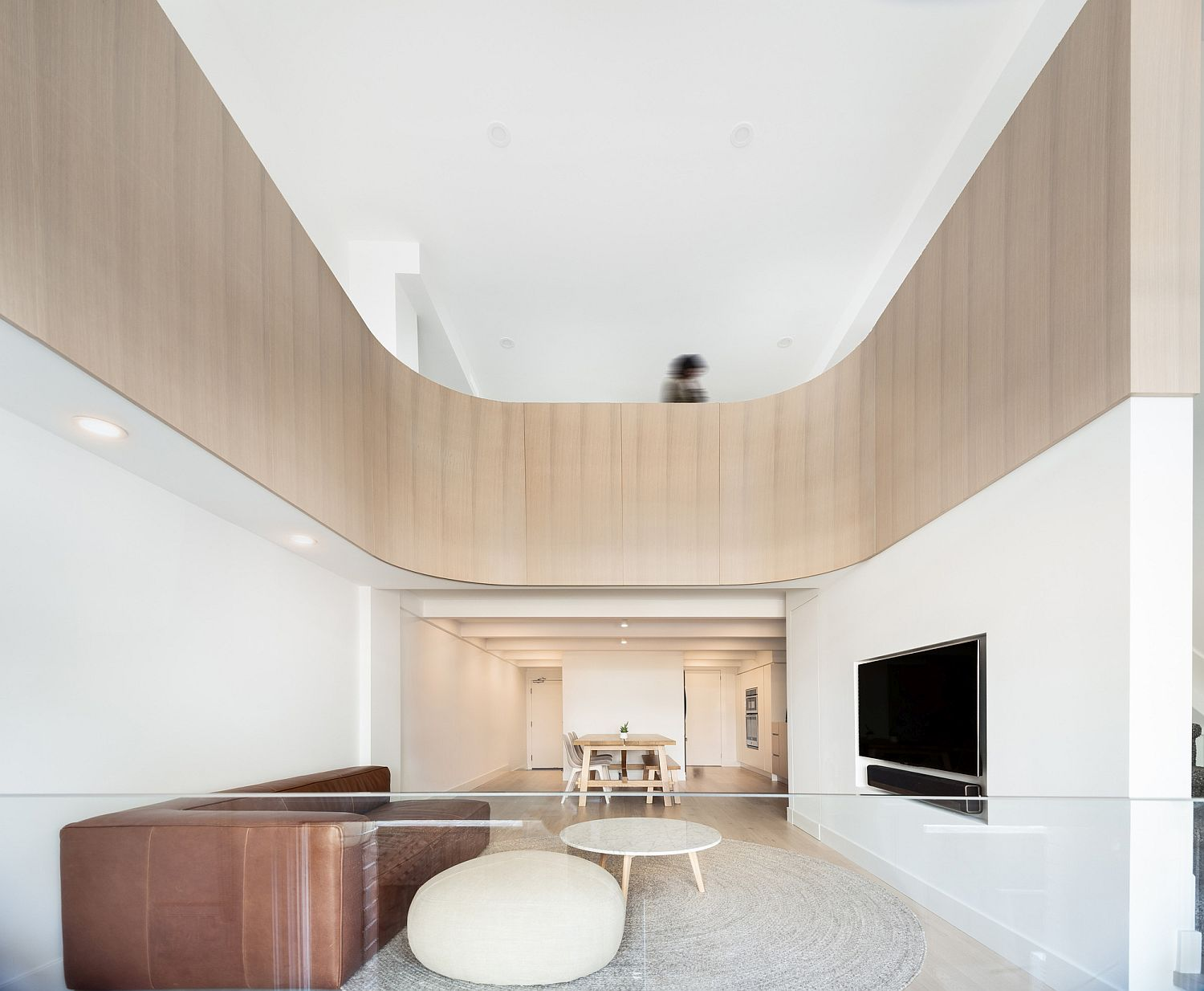 This Minimal Loft Inside a Converted Toronto Charm Has a Special Curved Surprise!