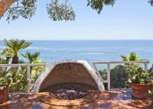 Design-of-the-fire-pit-on-the-Mediterranean-style-patio-protects-it-from-gusty-coastal-winds-217x155