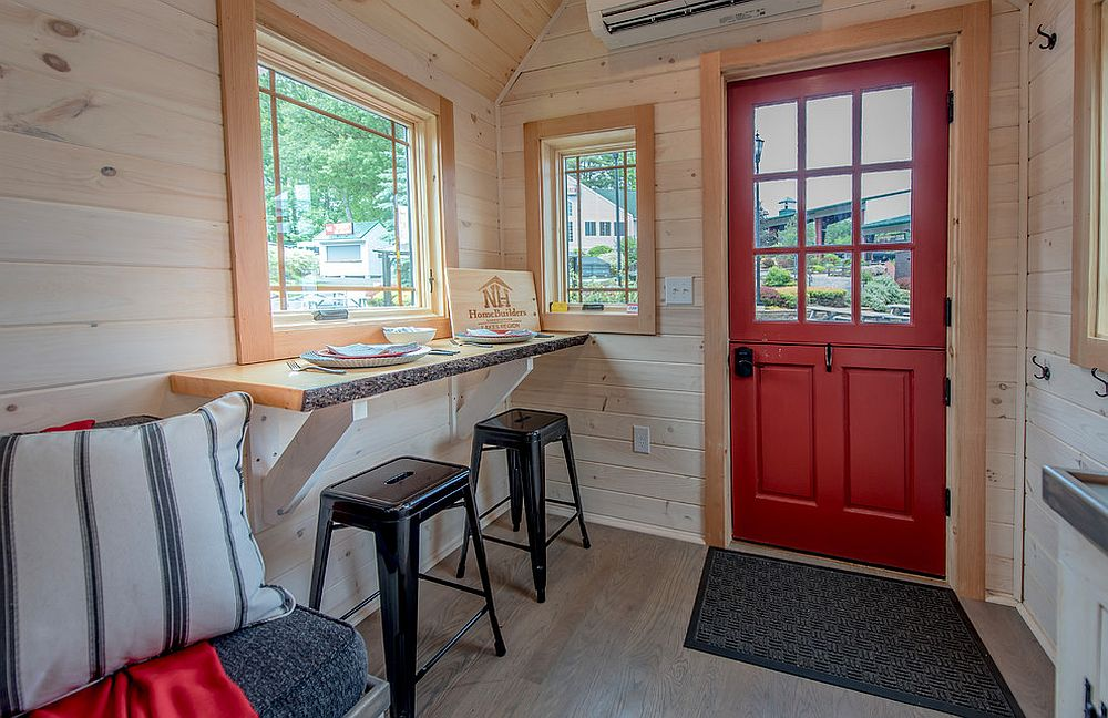 Dining and desk area rolled into one inside the tiny house