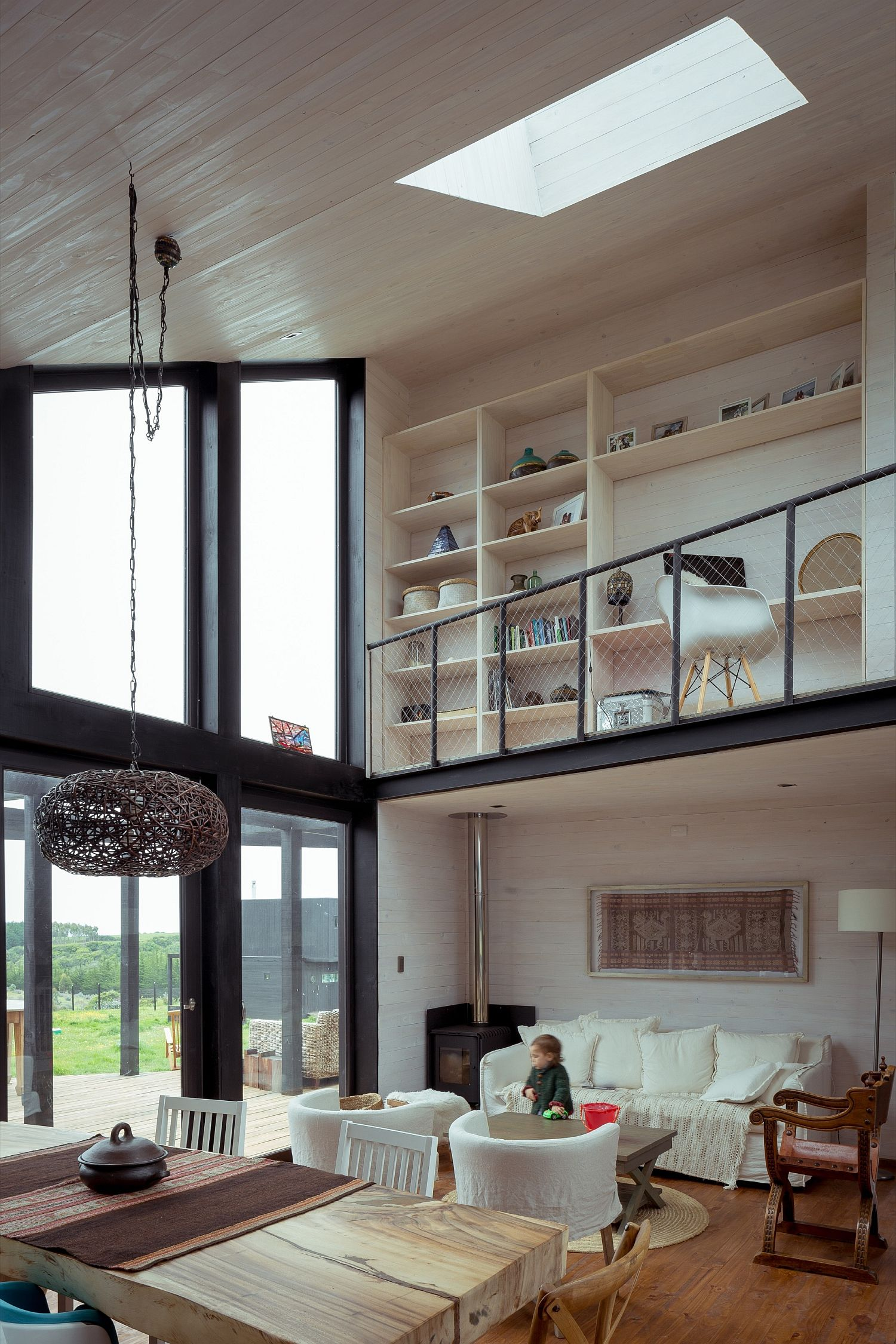 Double-height living area of the house with skylight