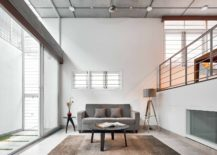 Double-height-living-area-on-split-level-with-sliding-glass-doors-that-usher-in-natural-light-217x155