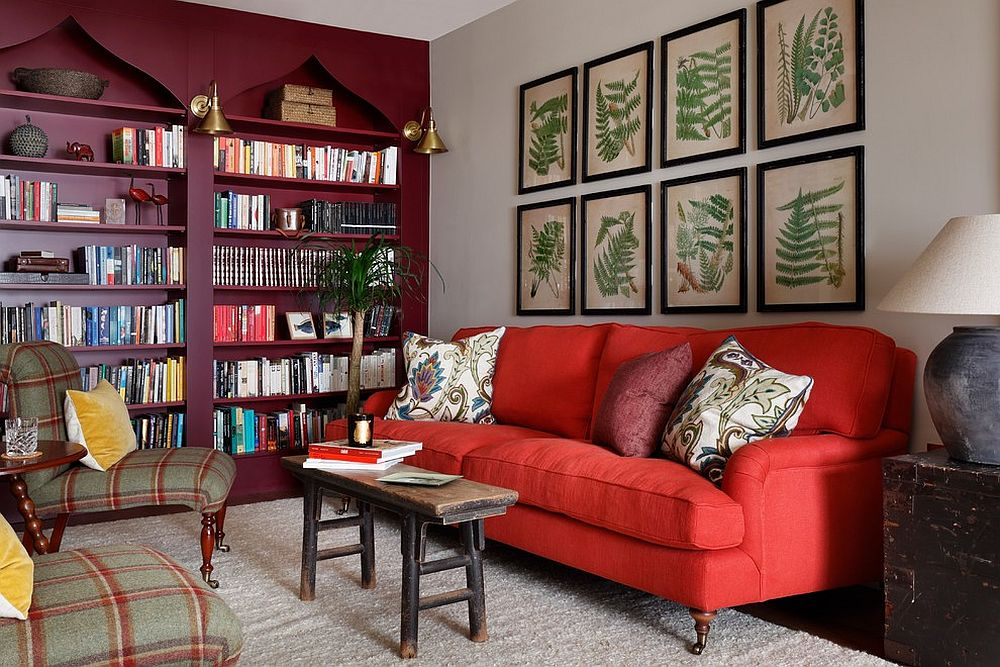 Eclectic living room in which the bookshelf and botanicals steal the show