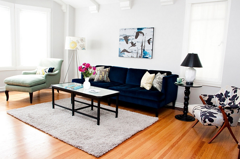 Eclectic living room with ample natural light and a bright navy blue sofa