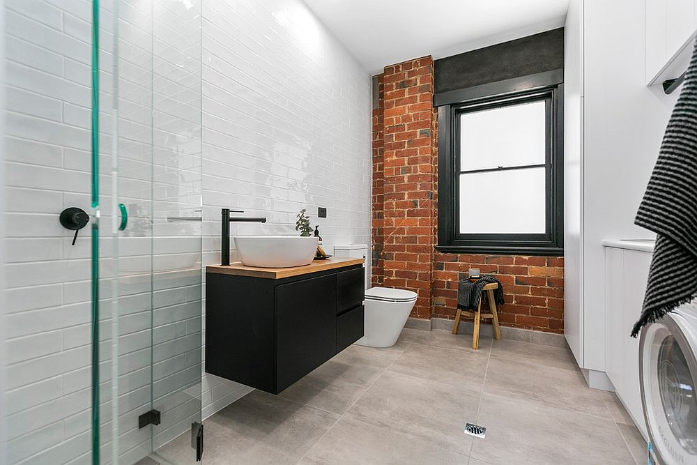Exposed brick wall section is a great way to add color and character to the contemporary bathroom