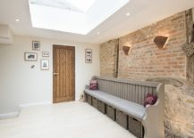 Exquisite-entry-with-brick-wall-backdrop-and-a-skylight-217x155
