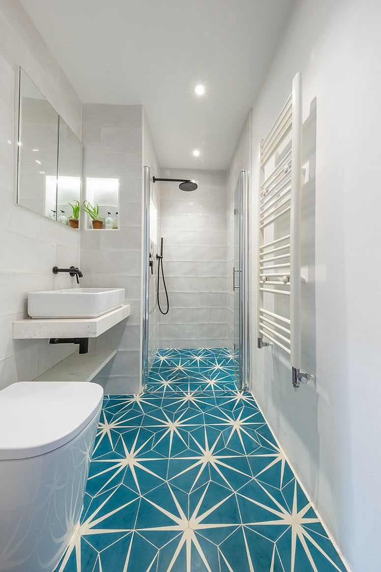 Fabulous tiles bring both color and pattern to the polished Mediterranean bathroom