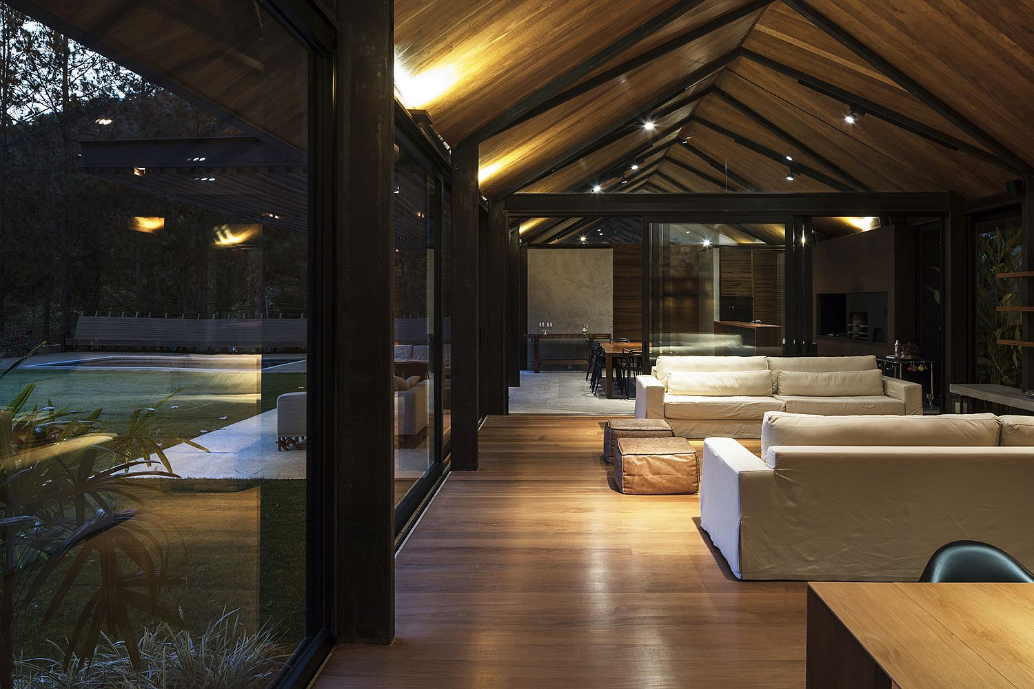 Floor-to-ceiling glass walls and sliding glass doors of the AS House